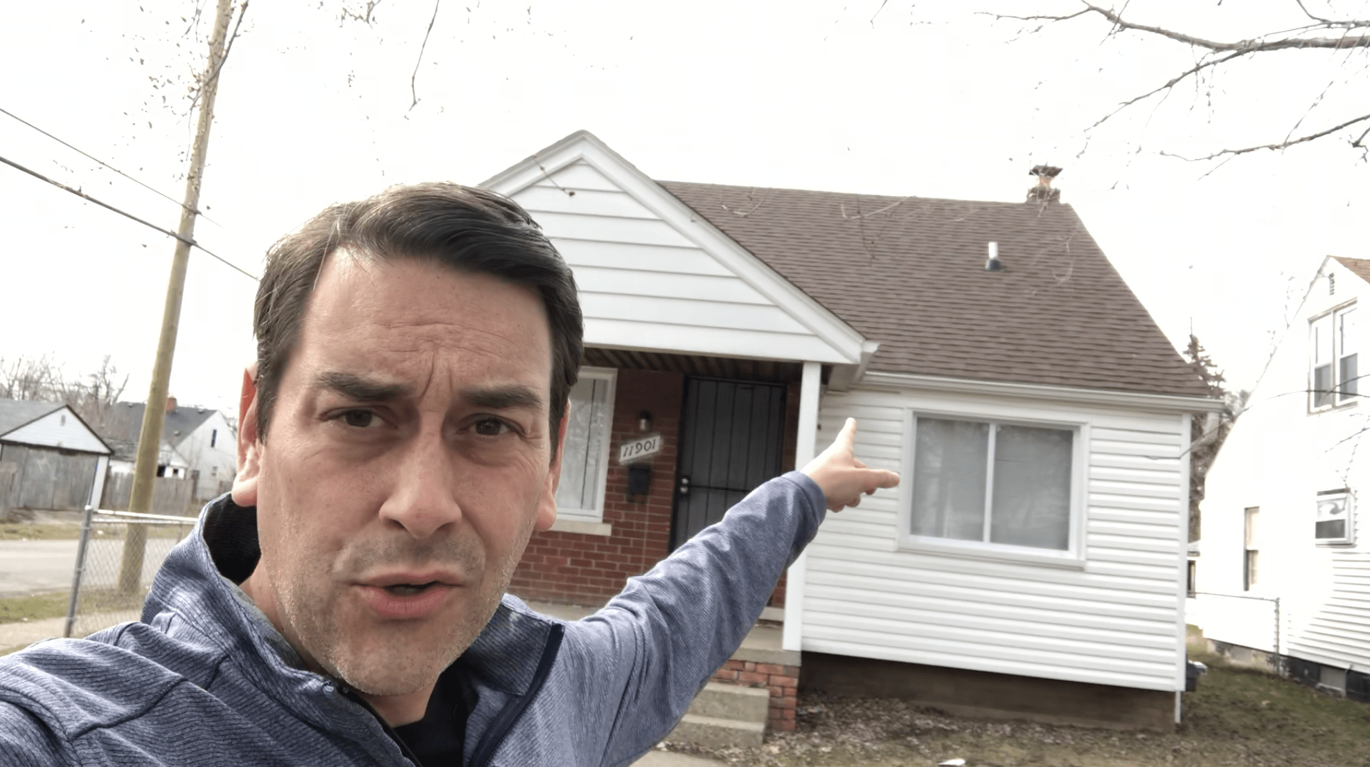 Clayton Morris pointing at rental property